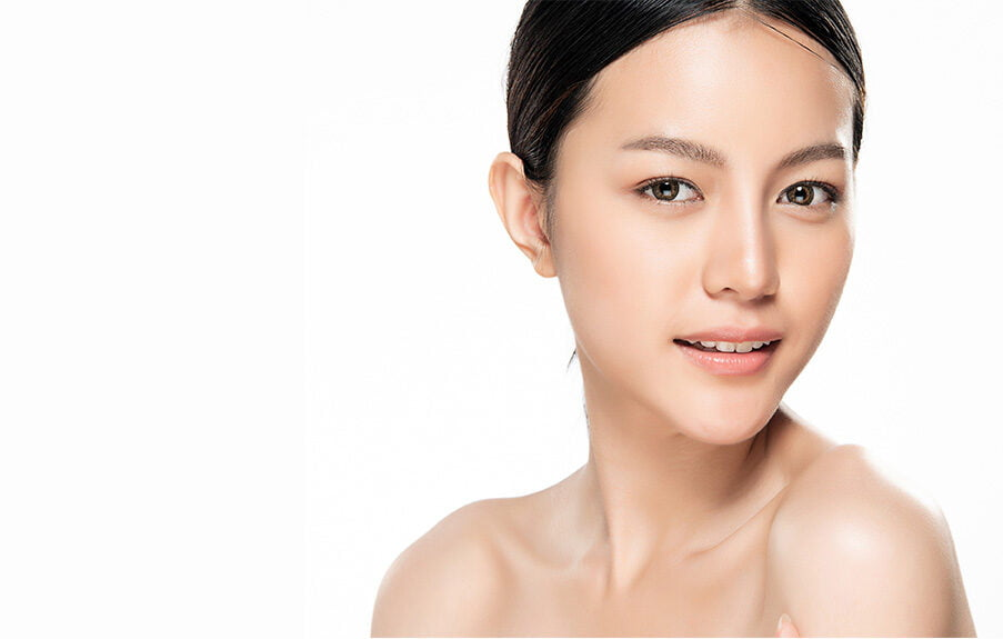 A pretty Asian woman with glowing skin is smiling